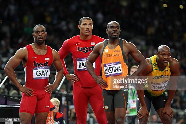 Tyson Gay Justin Gatlin of the United States Churandy Martina of Netherlands and Asafa Powell of Jamaica look to the scoreboard after competing the...