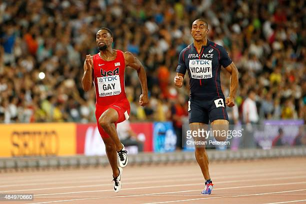 Tyson Gay of the United States and Jimmy Vicaut of France compete in the Men's 100 metres semifinal during day two of the 15th IAAF World Athletics...