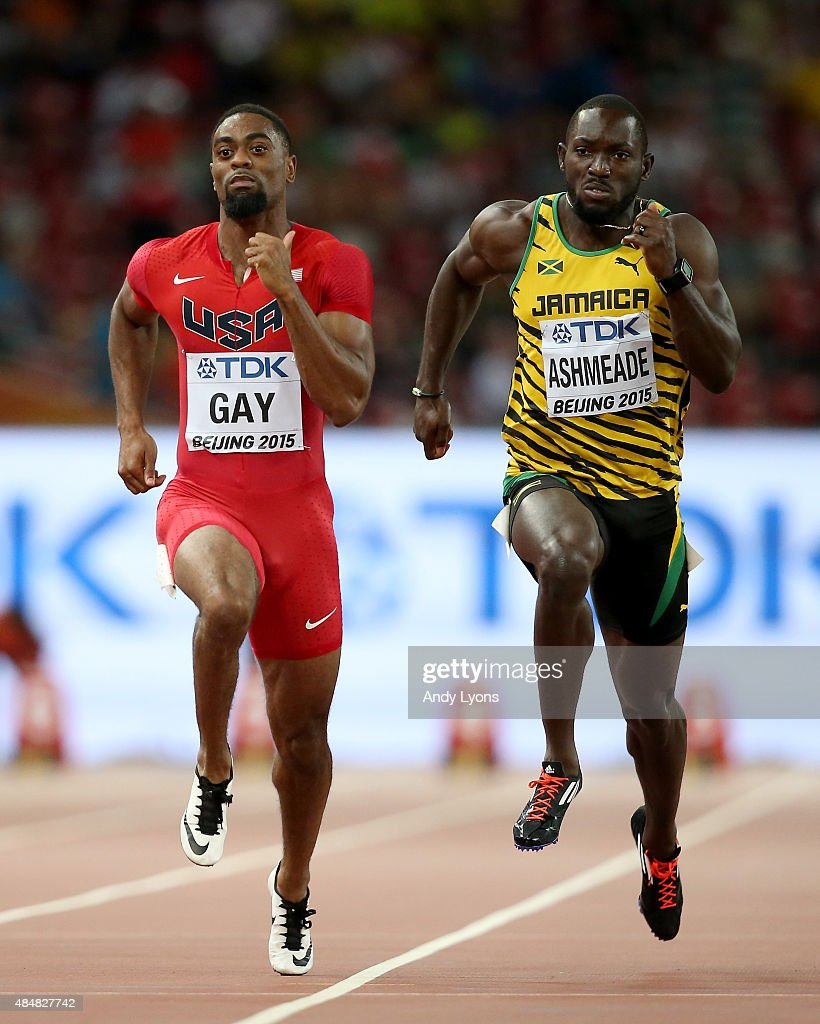 Tyson Gay of the United States (L) and Nickel Ashmeade of Jamaica compete in the Men's 100 metres heats during day one of the 15th IAAF World Athletics Championships Beijing 2015 at Beijing National Stadium on August 22, 2015 in Beijing, China.