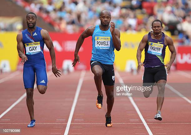 Tyson Gay of USA and Asafa Powell of Jamaica in action in the men's 100m Final during the Aviva British Grand Prix at Gateshead International Stadium...