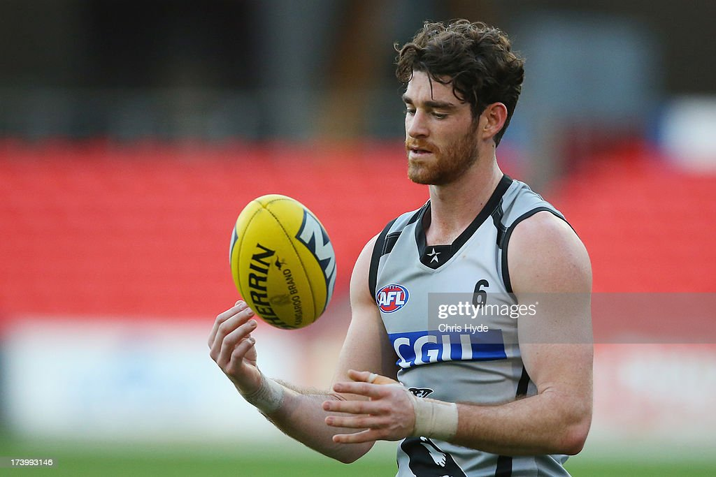 Tyson Goldsack looks on during a Collingwood Magpies AFL training session at Metricon Stadium on July 19, 2013 in Gold Coast, Australia.