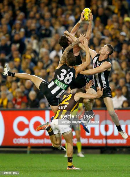 Tyson Goldsack of the Magpies attempts to mark the ball during the round nine AFL match between the Collingwood Magpies and the Hawthorn Hawks at...
