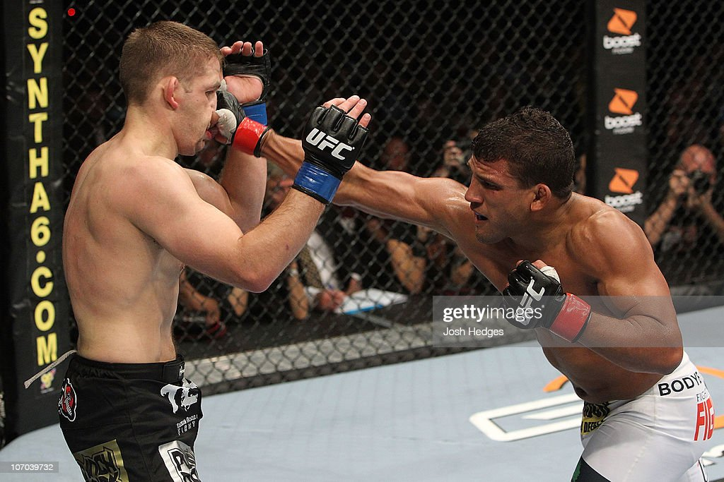 Tyson Griffin lands a punch to the face against Nik Lentz during their Lightweight bout part of UFC 123 at the Palace of Auburn Hills on November 20...