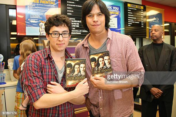 Tyson Houseman and Chaske Spencer hand out New Moon DVD's at the 'The Twilight Saga New Moon' DVD release at Blockbuster Brookhaven on March 19 2010...