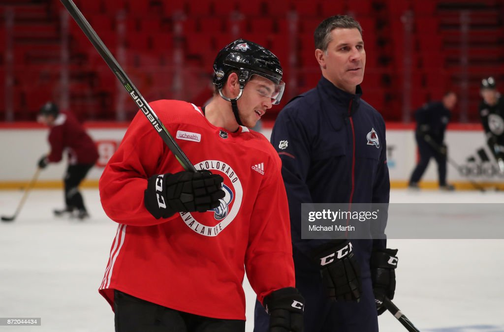Tyson Jost #17 and head coach Jared Bednar of the Colorado Avalanche chat during practice at the Ericsson Globe on November 8, 2017 in Stockholm, Sweden.