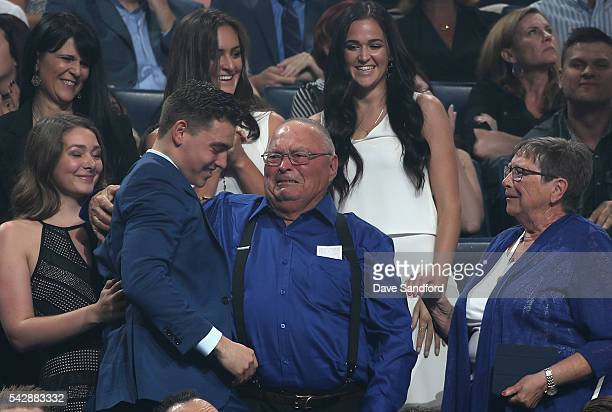 Tyson Jost celebrates with his family after being selected tenth overall by the Colorado Avalanche during round one of the 2016 NHL Draft at First...