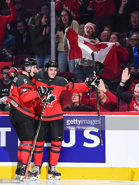 Tyson Jost of Team Canada celebrates his goal with teammate Thomas Chabot during the IIHF exhibition game against Team Finland at the Bell Centre on...