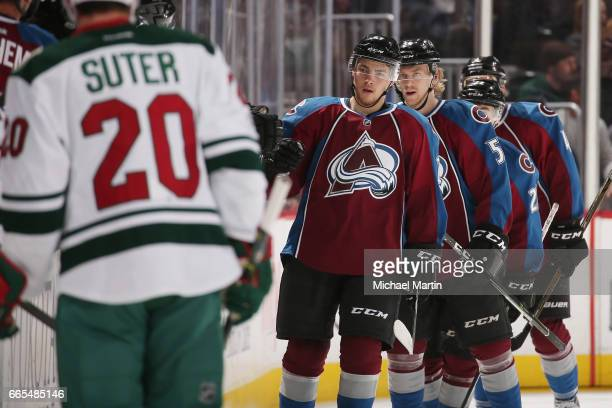 Tyson Jost of the Colorado Avalanche celebrates with his bench after scoring his first career NHL goal against the Minnesota Wild at the Pepsi Center...