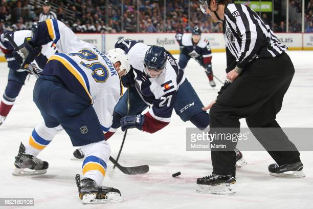 Tyson Jost of the Colorado Avalanche faces off against Kyle Brodziak of the St Louis Blues at the Pepsi Center on March 31 2017 in Denver Colorado