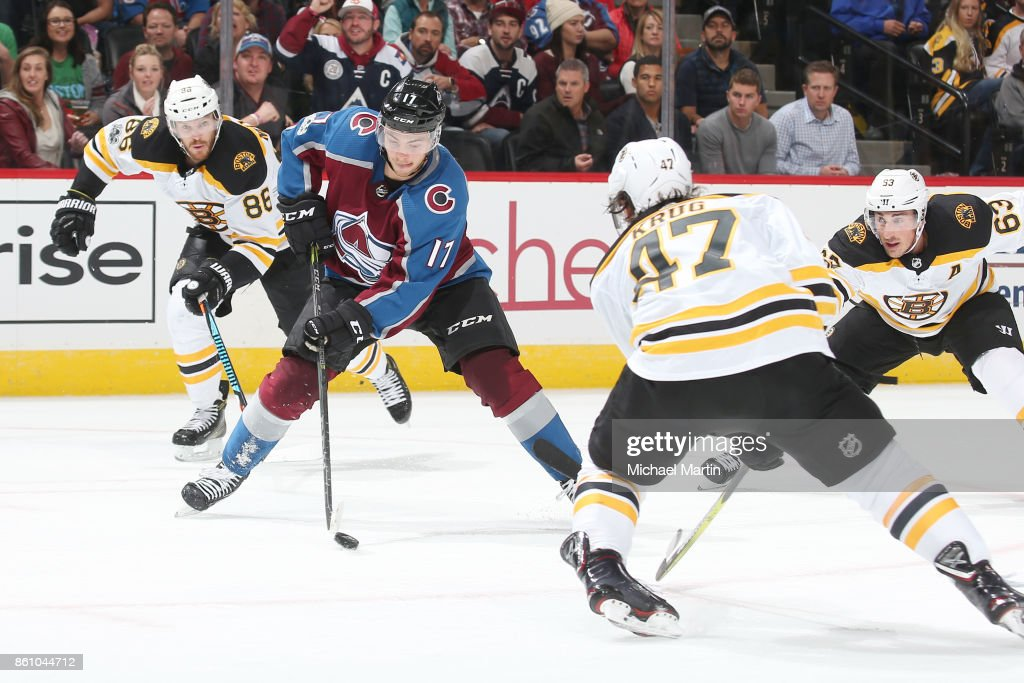 Tyson Jost #17 of the Colorado Avalanche skates against Torey Krug #47 of the Boston Bruins at the Pepsi Center on October 11, 2017 in Denver, Colorado. The Avalanche defeated the Bruins 6-3.