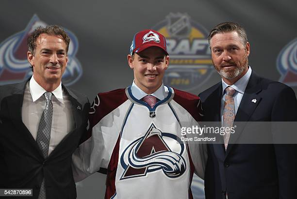 Tyson Jost poses for a photo onstage with general manager Joe Sakic left and head coach Patrick Roy right after being selected tenth overall by the...