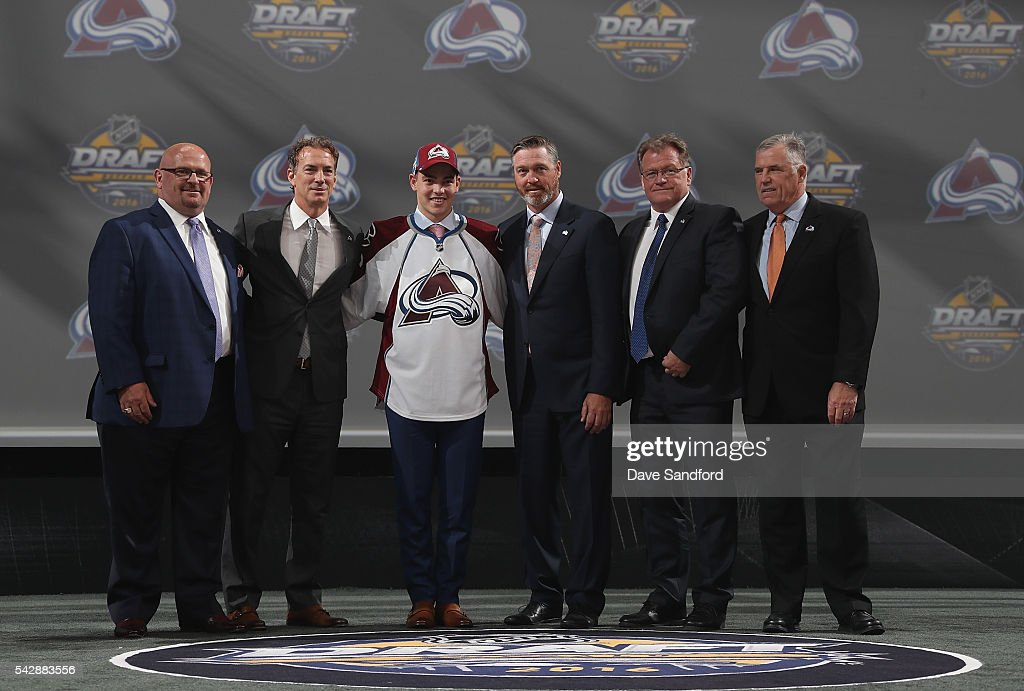 Tyson Jost poses for a photo onstage with general manager Joe Sakic, head coach Patrick Roy and team personnel after being selected tenth overall by the Colorado Avalanche during round one of the 2016 NHL Draft at First Niagara Center on June 24, 2016 in Buffalo, New York.