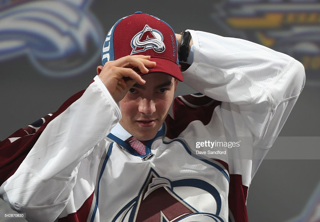 <a gi-track='captionPersonalityLinkClicked' href=/galleries/search?phrase=Tyson+Jost&family=editorial&specificpeople=13789246 ng-click='$event.stopPropagation()'>Tyson Jost</a> puts on his hat onstage after being selected tenth overall by the Colorado Avalanche during round one of the 2016 NHL Draft at First Niagara Center on June 24, 2016 in Buffalo, New York.