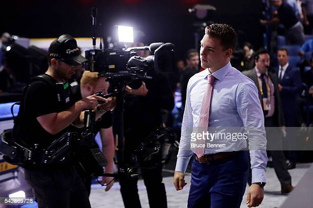 Tyson Jost reacts after being selected tenth overall by the Colorado Avalanche during round one of the 2016 NHL Draft on June 24 2016 in Buffalo New...