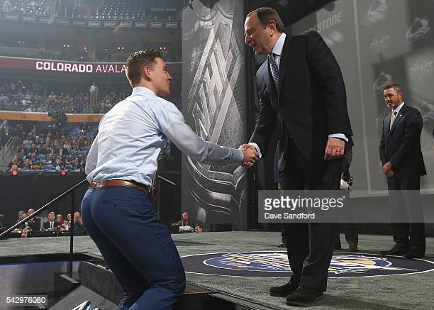 Tyson Jost shakes the hand of NHL Commissioner Gary Bettman after being selected tenth overall by te Colorado Avalanche during round one of the 2016...