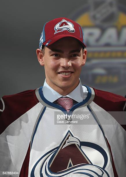 Tyson Jost smiles onstage after being selected tenth overall by the Colorado Avalanche during round one of the 2016 NHL Draft at First Niagara Center...