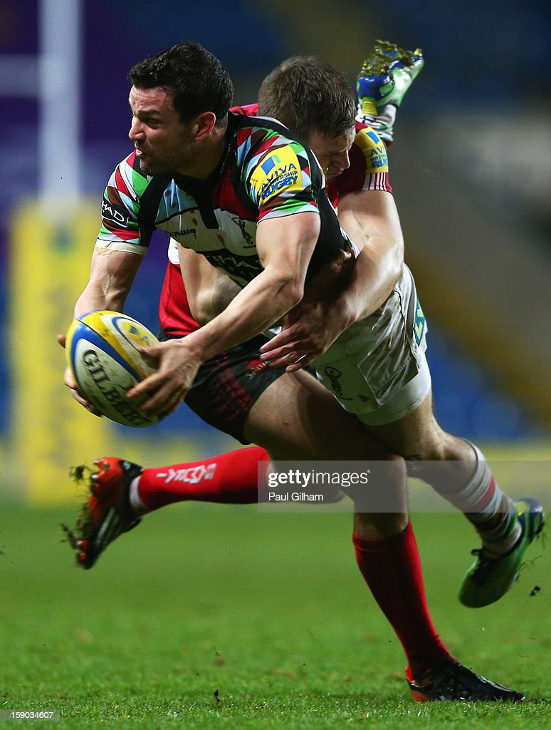 Tyson Keates of Harlequins is challenged by Nick Scott of London Welsh during the Aviva Premiership match between London Welsh and Harlequins at Kassam Stadium on January 6, 2013 in Oxford, England.