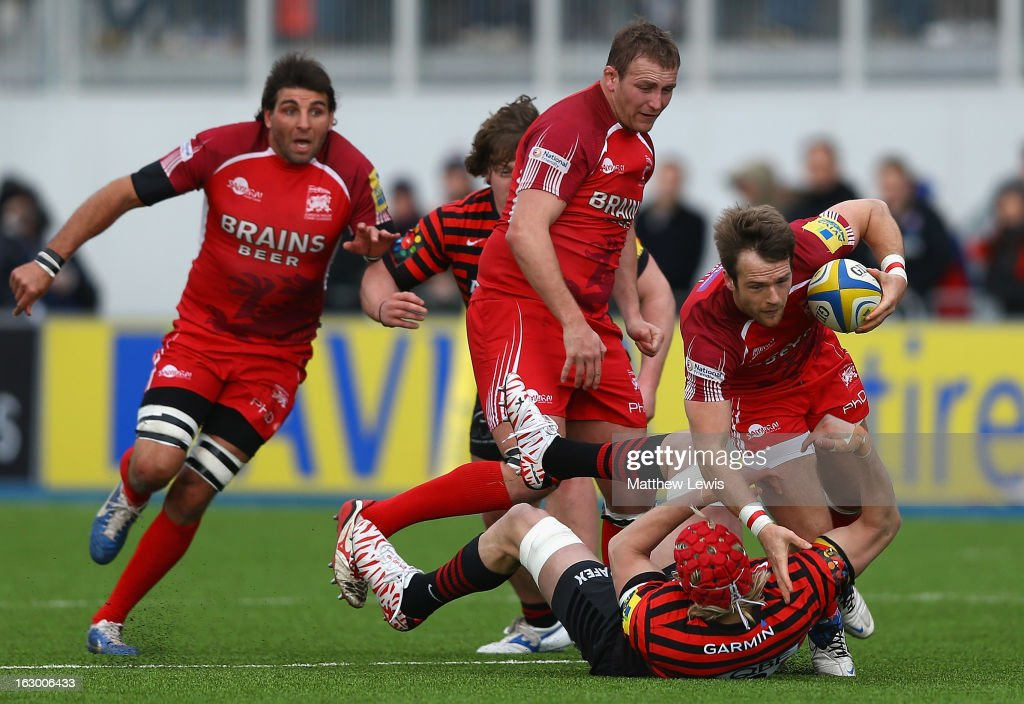 Tyson Keats of London Welsh is tackled by Jackson Wray of Saracens during the Aviva Premiership match between Saracens and London Welsh at Allianz Park on March 3, 2013 in Barnet, England.