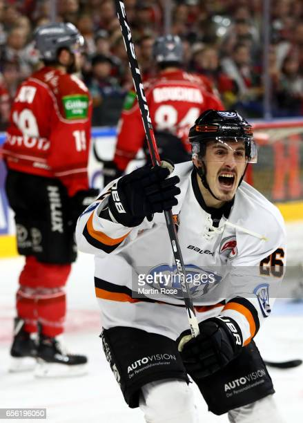 Tyson Mulock of Wolfsburg celebrates after he scores the opening goal during the DEL Playoffs quarter finals Game 7 between Koelner Haie and Grizzlya...