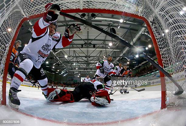 Tyson Mulock of Wolfsburg scores his team's opening goal during the DEL match between Grizzly Adams Wolfsburg and Koelner Haie at BraWo Ice Arena on...