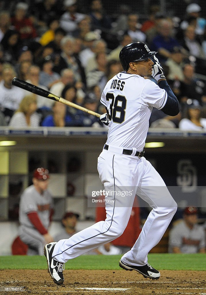 Tyson Ross #38 of the San Diego Padres hits a single during the fifth inning of a baseball game against the Arizona Diamondbacks at Petco Park on September 24, 2013 in San Diego, California.