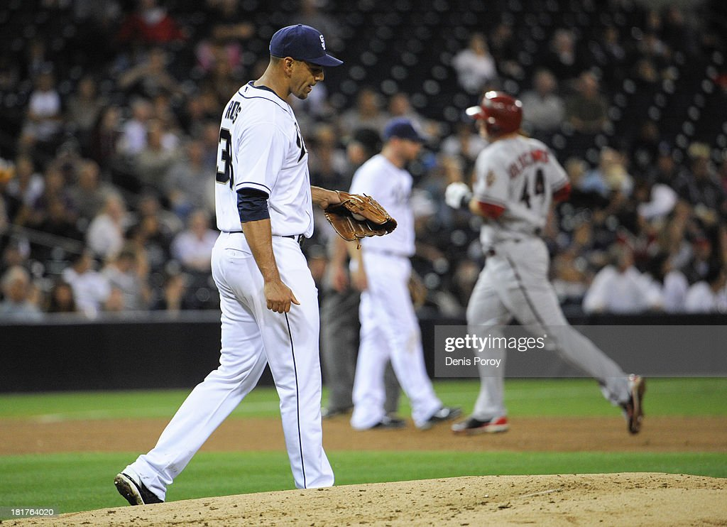 Tyson Ross #38 of the San Diego Padres walks back to the mound as <a gi-track='captionPersonalityLinkClicked' href=/galleries/search?phrase=Paul+Goldschmidt&family=editorial&specificpeople=7511120 ng-click='$event.stopPropagation()'>Paul Goldschmidt</a> #44 of the Arizona Diamondbacks rounds the bases on a solo home run during the sixth inning of a baseball game at Petco Park on September 24, 2013 in San Diego, California.