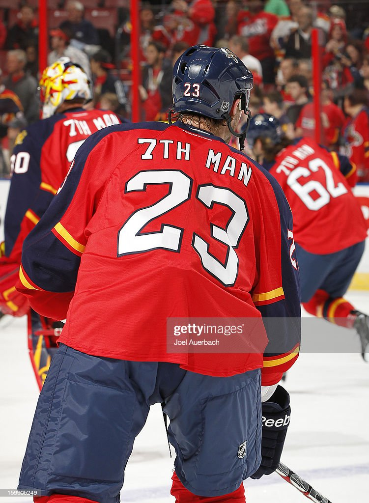 Tyson Strachan #23 along with the rest of the Florida Panthers wear 7th Man jerseys in honor of their fans during the warm up prior to the game against the Carolina Hurricanes during the season opener at the BB&T Center on January 19, 2013 in Sunrise, Florida.The Panthers defeated the Hurricanes 5-1.