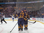 Tyson Strachan and Tyler Myers of the Buffalo Sabres celebrate a goal against the Toronto Maple Leafs on November 15 2014 at the First Niagara Center...
