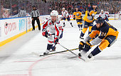 Tyson Strachan of the Buffalo Sabres battles for the puck against Evgeny Kuznetsov of the Washington Capitals on March 16 2015 at the First Niagara...