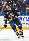 Tyson Strachan of the Buffalo Sabres follows the play against the Winnipeg Jets at First Niagara Center on November 26 2014 in Buffalo New York...