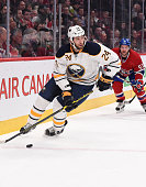 Tyson Strachan of the Buffalo Sabres skates with the puck against the Montreal Canadiens in the NHL game at the Bell Centre on February 3 2015 in...
