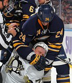 Tyson Strachan of the Buffalo Sabres takes down Patric Hornqvist of the Pittsburgh Penguins on November 8 2014 at the First Niagara Center in Buffalo...
