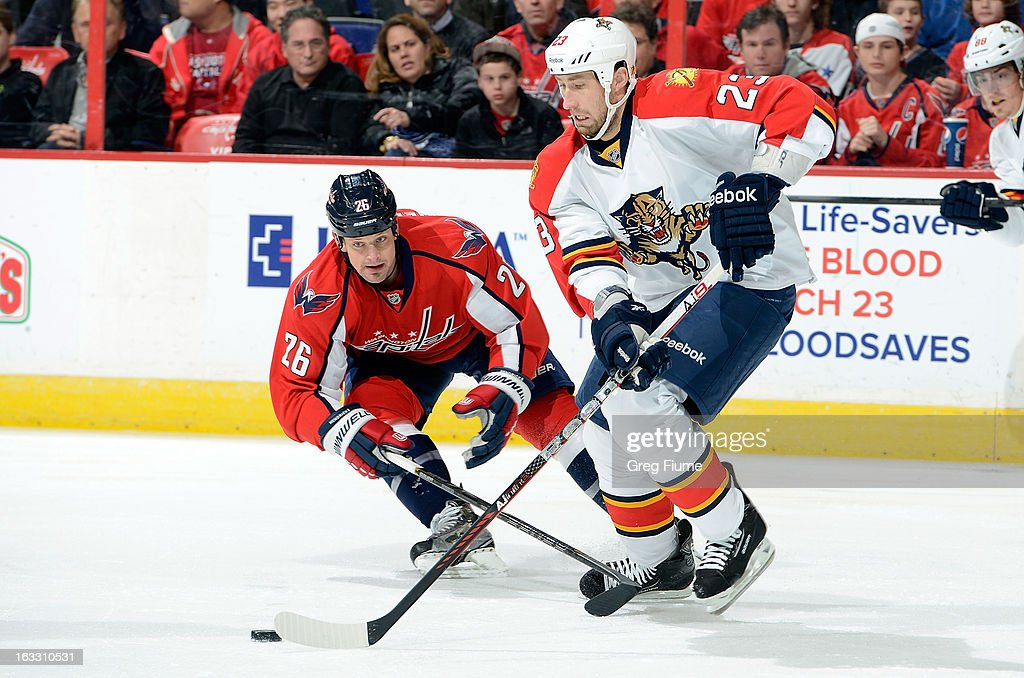 Tyson Strachan #23 of the Florida Panthers handles the puck against <a gi-track='captionPersonalityLinkClicked' href=/galleries/search?phrase=Matt+Hendricks&family=editorial&specificpeople=4537275 ng-click='$event.stopPropagation()'>Matt Hendricks</a> #26 of the Washington Capitals at the Verizon Center on March 7, 2013 in Washington, DC.