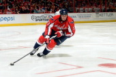 Tyson Strachan of the Washington Capitals controls the puck in the third period against the St Louis Blues during an NHL game at Verizon Center on...