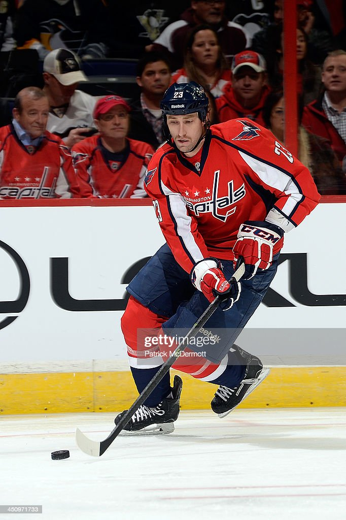 <a gi-track='captionPersonalityLinkClicked' href=/galleries/search?phrase=Tyson+Strachan&family=editorial&specificpeople=5646502 ng-click='$event.stopPropagation()'>Tyson Strachan</a> #23 of the Washington Capitals controls the puck in the first period against the Pittsburgh Penguins during an NHL game at Verizon Center on November 20, 2013 in Washington, DC.