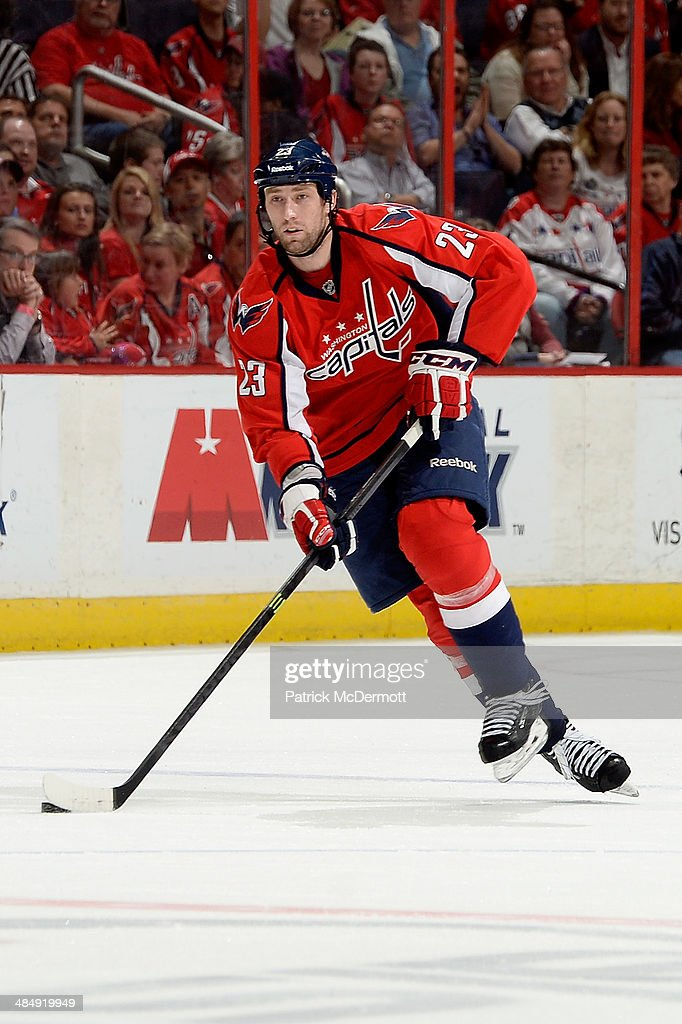<a gi-track='captionPersonalityLinkClicked' href=/galleries/search?phrase=Tyson+Strachan&family=editorial&specificpeople=5646502 ng-click='$event.stopPropagation()'>Tyson Strachan</a> #23 of the Washington Capitals controls the puck in the second period during an NHL game against the Chicago Blackhawks at Verizon Center on April 11, 2014 in Washington, DC.