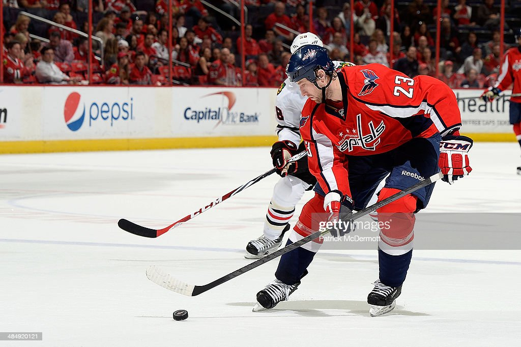 <a gi-track='captionPersonalityLinkClicked' href=/galleries/search?phrase=Tyson+Strachan&family=editorial&specificpeople=5646502 ng-click='$event.stopPropagation()'>Tyson Strachan</a> #23 of the Washington Capitals controls the puck in the third period during an NHL game against the Chicago Blackhawks at Verizon Center on April 11, 2014 in Washington, DC.