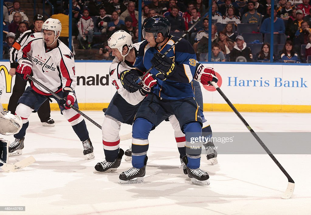 <a gi-track='captionPersonalityLinkClicked' href=/galleries/search?phrase=Tyson+Strachan&family=editorial&specificpeople=5646502 ng-click='$event.stopPropagation()'>Tyson Strachan</a> #23 of the Washington Capitals defends against <a gi-track='captionPersonalityLinkClicked' href=/galleries/search?phrase=Jaden+Schwartz&family=editorial&specificpeople=7029354 ng-click='$event.stopPropagation()'>Jaden Schwartz</a> #9 of the St. Louis Blues during an NHL game on April 8, 2014 at Scottrade Center in St. Louis, Missouri.
