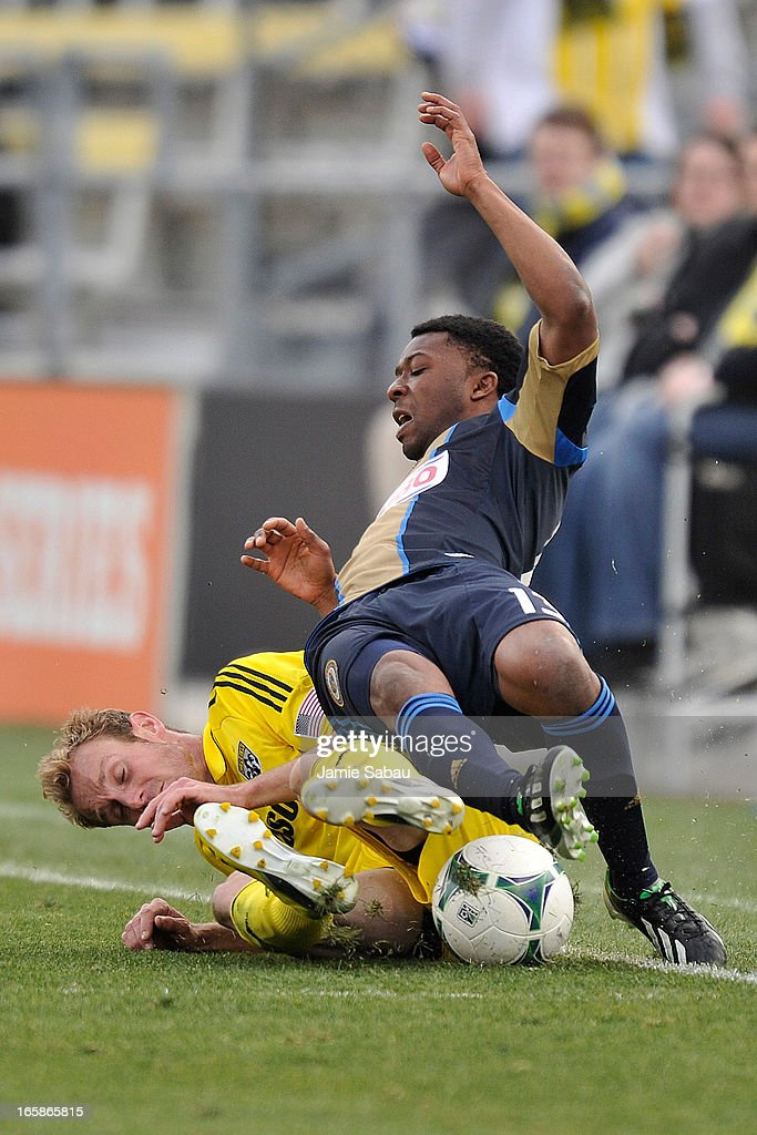 Tyson Wahl #2 of the Columbus Crew takes down Michael Lahoud #13 of Philadelphia Union in the second half on April 6, 2013 at Crew Stadium in Columbus, Ohio. Wahl was given a yellow card caution for the play.