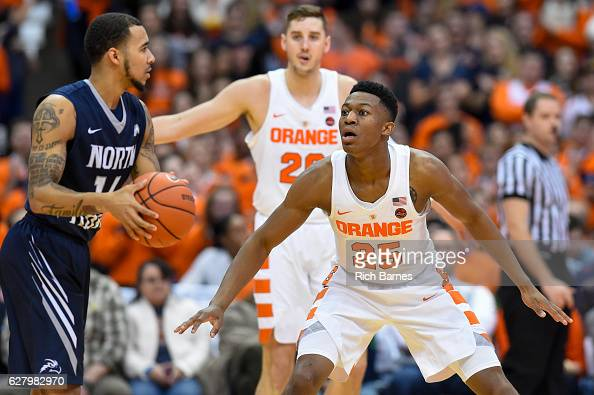 Tyus Battle of the Syracuse Orange defends Dallas Moore of the North Florida Ospreys as Tyler Lydon of the Syracuse Orange looks on a during the...