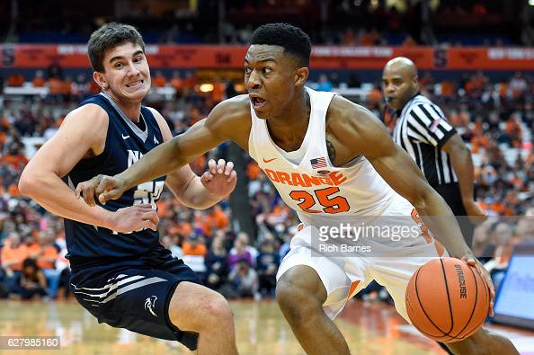 Tyus Battle of the Syracuse Orange drives to the basket past Benedikt Haid of the North Florida Ospreys during the second half at the Carrier Dome on...
