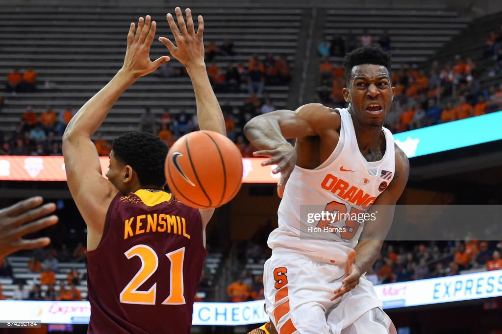 Tyus Battle #25 of the Syracuse Orange passes the ball around the defense of Gavin Kensmil #21 of the Iona Gaels during the first half at the Carrier Dome on November 14, 2017 in Syracuse, New York.