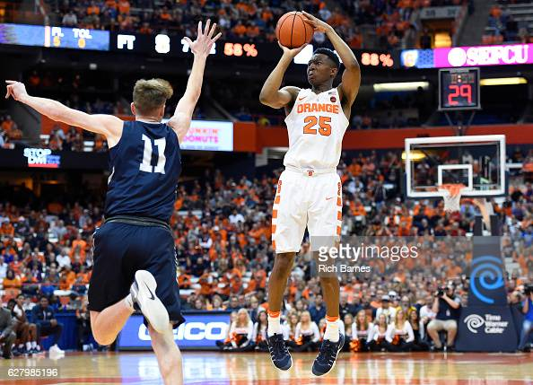 Tyus Battle of the Syracuse Orange shoots the ball as Garrett Sams of the North Florida Ospreys defends during the second half at the Carrier Dome on...