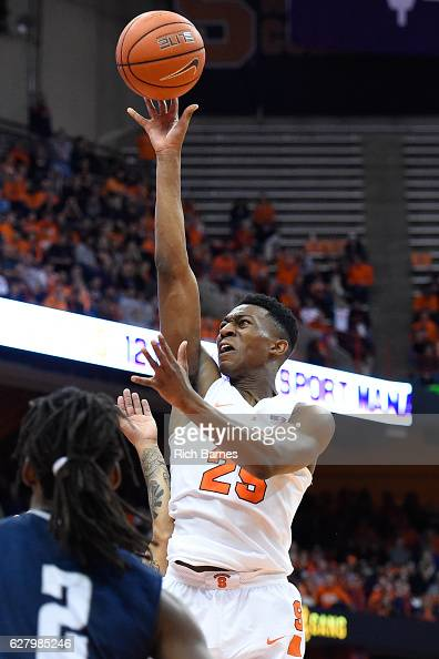 Tyus Battle of the Syracuse Orange shoots the ball as Wajid Aminu of the North Florida Ospreys defends during the second half at the Carrier Dome on...