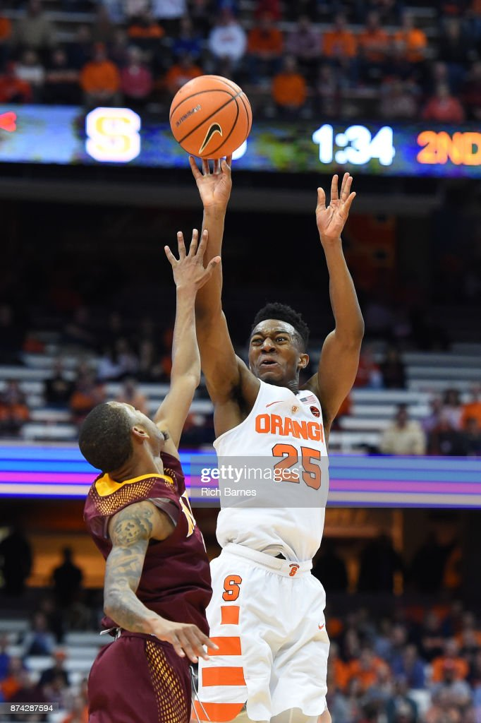 Tyus Battle #25 of the Syracuse Orange shoots the ball over Zach Lewis #1 of the Iona Gaels during the second half at the Carrier Dome on November 14, 2017 in Syracuse, New York. Syracuse defeated Iona 71-62.