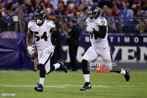Tyus Bowser and Kamalei Correa of the Baltimore Ravens run on a kick off against the Washington Redskins during a preseason game at MT Bank Stadium...