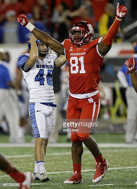 Tyus Bowser of the Houston Cougars celebrates as kicker Jake Elliott of the Memphis Tigers grabs his head after missing a 48 yard field goal attempt...