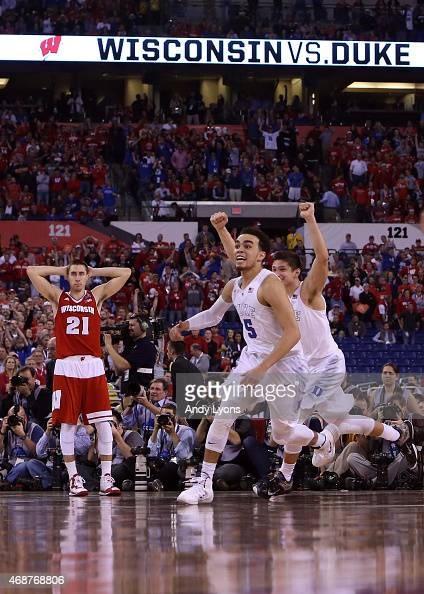 Tyus Jones and Grayson Allen of the Duke Blue Devils celebrate after defeating the Wisconsin Badgers as Josh Gasser looks on during the NCAA Men's...