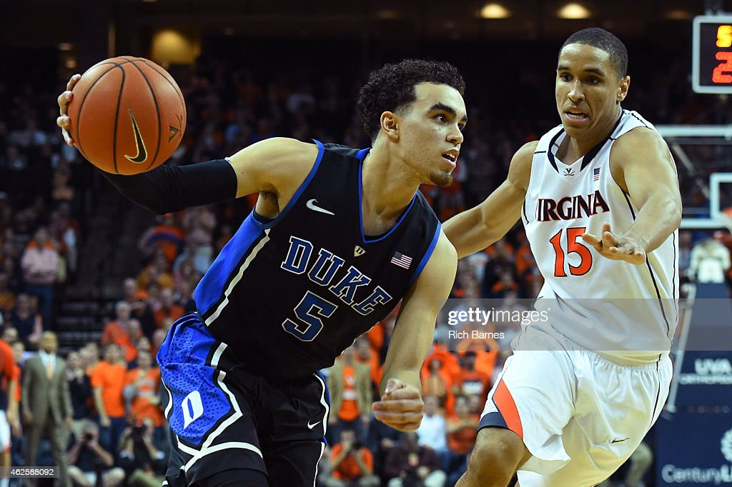 <a gi-track='captionPersonalityLinkClicked' href=/galleries/search?phrase=Tyus+Jones&family=editorial&specificpeople=10012848 ng-click='$event.stopPropagation()'>Tyus Jones</a> #5 of the Duke Blue Devils drives to the basket past <a gi-track='captionPersonalityLinkClicked' href=/galleries/search?phrase=Malcolm+Brogdon&family=editorial&specificpeople=8768599 ng-click='$event.stopPropagation()'>Malcolm Brogdon</a> #15 of the Virginia Cavaliers during the second half at John Paul Jones Arena on January 31, 2015 in Charlottesville, Virginia. Duke defeated Virginia 69-63.