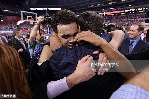 Tyus Jones of the Duke Blue Devils hugs head coach head coach Mike Krzyzewski after defeating the Wisconsin Badgers during the NCAA Men's Final Four...